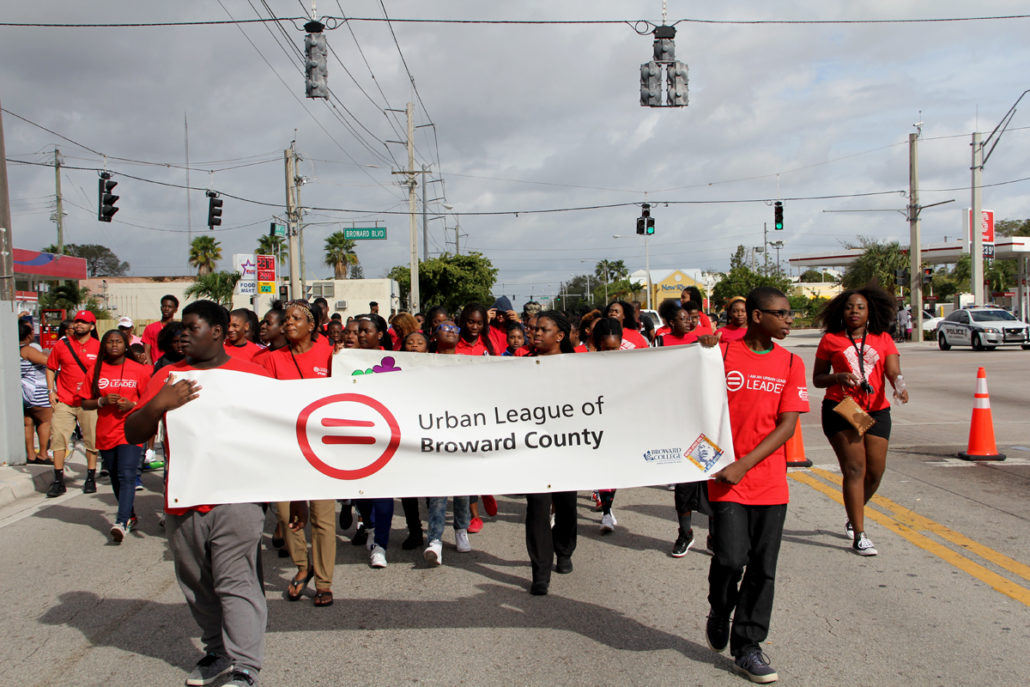 Group of YPN Members walking together holding a sign for the Urban League of Broward County