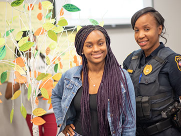 Young woman standing with a police officer